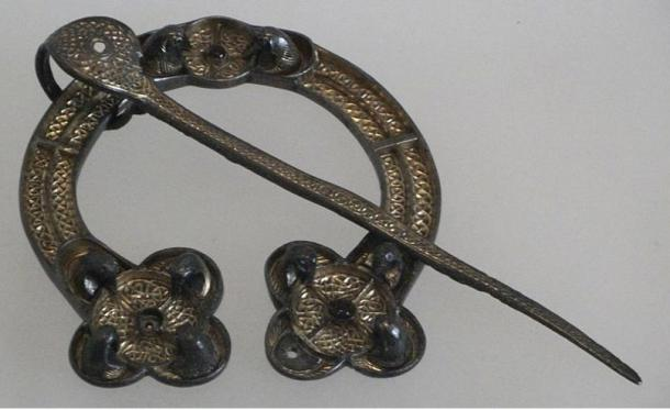 The Rogart brooch, a Pictish penannular brooch, Scotland, 8th century, silver with gilding and glass.