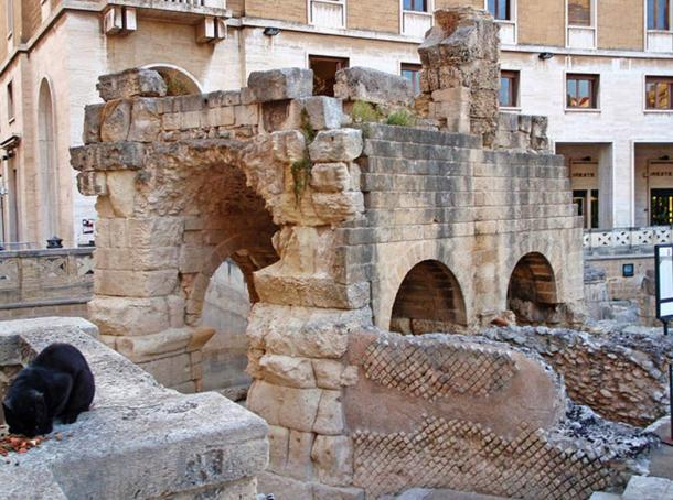 Roman amphitheater of Augustan (early 1st c. CE) date with probable Hadrianic (117-138 CE) renovations, partially dug out of the bedrock and partially built up.