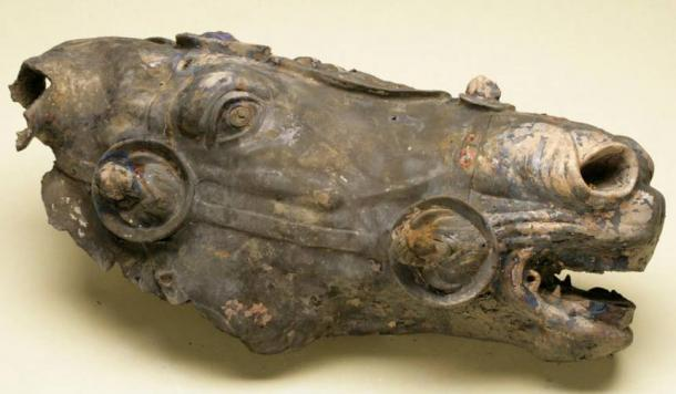 The Roman bronze horse head before restoration.