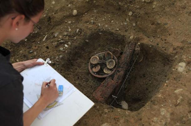 A researcher documents the Roman find.