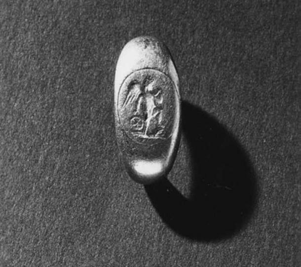 """A Roman gold ring from the 3rd century AD depicting the figure of Cupid (""""desire"""" –god of love) holding a ball, one leg on a rock. Walters Art Museum."""
