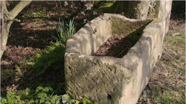 The child's stone coffin.