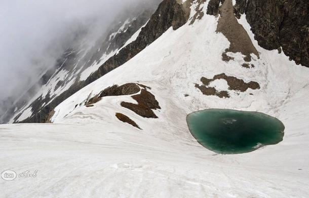 Roopkund Lake likes in the harsh terrain of the Himalayas