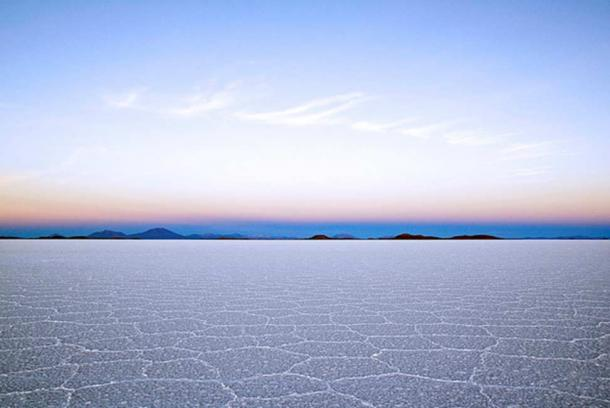 """Salar de Uyuni is part of the Altiplano of Bolivia in South America. The Altiplano is a high plateau, which was formed during uplift of the Andes mountains. The plateau includes fresh and saltwater lakes as well as salt flats."""