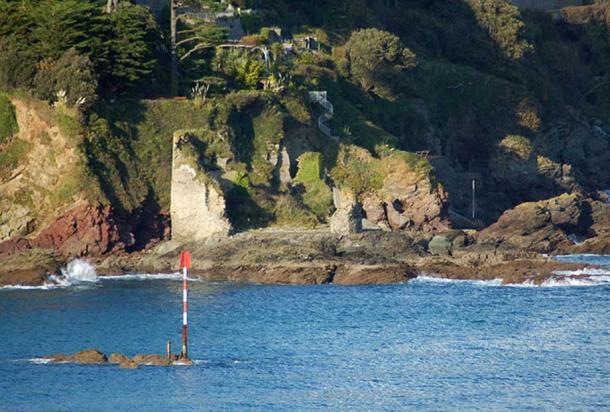 Salcombe Castle with its red rocks, which may have been thought to have been stained red by giants' blood