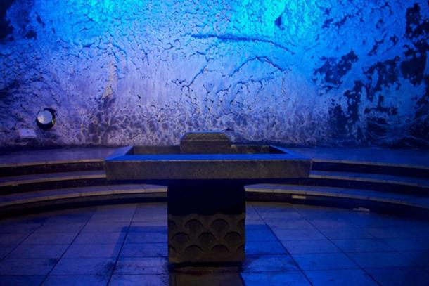 Salt alter with waterfall behind it.