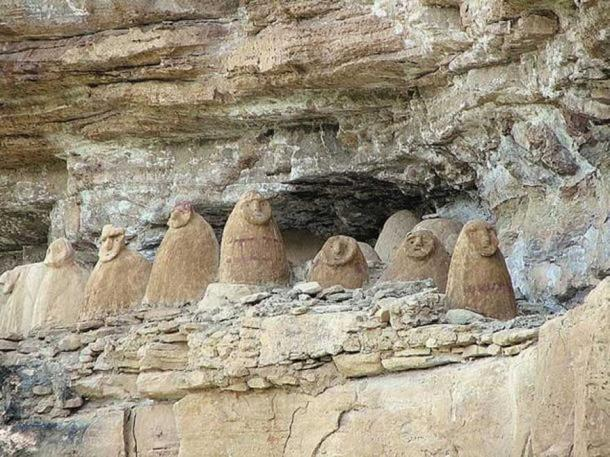 Sarcophagi on a cliff face, Chachapoyas, Amazonas, Peru.