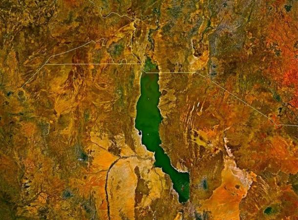 Satellite image of Lake Turkana: Note the jade color. The Omo River enters at the top. The river visible on the lower left is the Turkwel, which has been dammed for hydroelectric power.
