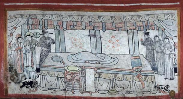 Scene depicting an empty bed with two pets on either side as well as male and female attendants (Chinese Cultural Relics photo)