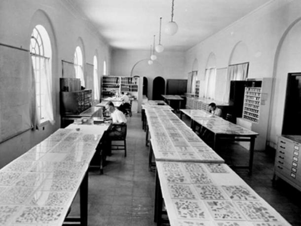 Scholars examining the Dead Sea Scroll fragments.