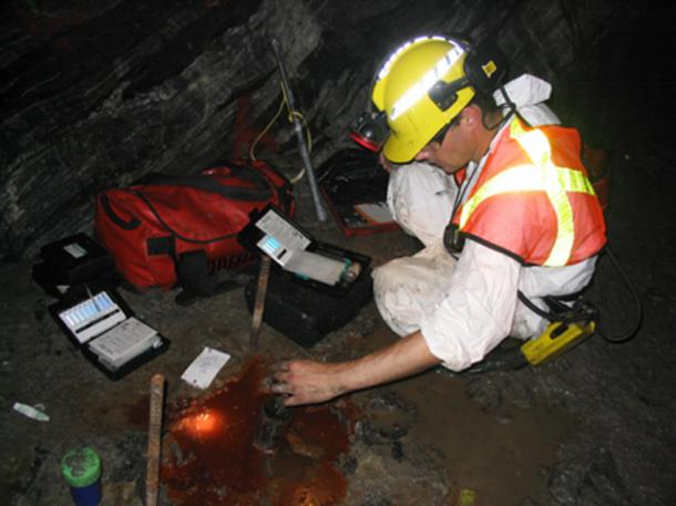 Scientist testing the world's oldest pool of water (Photo by Barbara Sherwood Lollar)