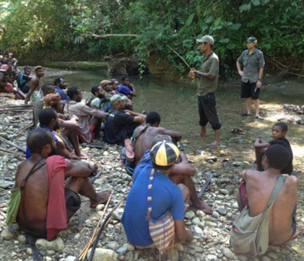 Scientists explaining their work to people who live near Aitape, Papua New Guinea, today.
