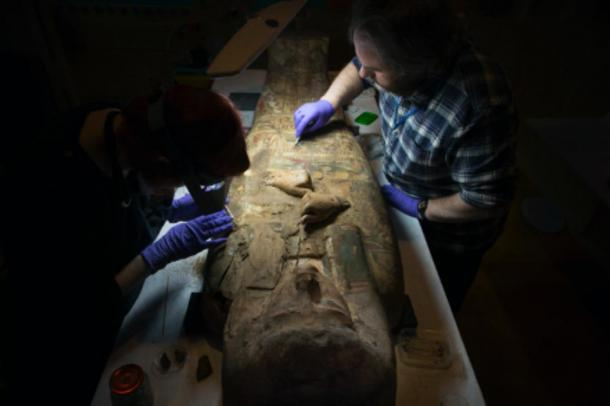 Scottish archaeologists examining the ancient Egyptian mummy sarcophagus. (Perth Museum and Art Gallery / Culture Perth and Kinross)