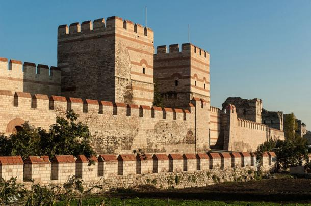 Section of existing (restored) three wall structure that once protected Constantinople. (dinosmichail /Adobe)