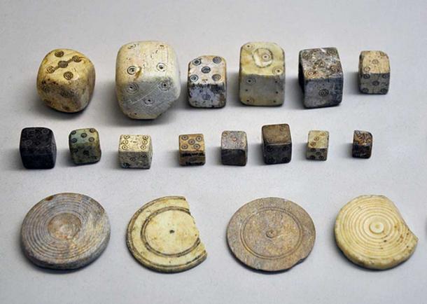 Selection of Roman era dice and jetons (tokens).