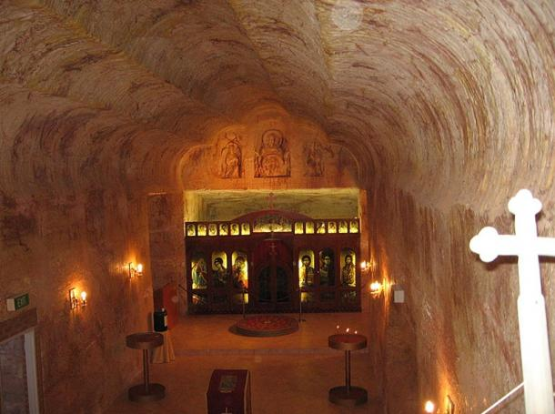 Interior of the Serbian Orthodox Church in Coober Pedy, South Australia. Like many of the dwellings in Coober Pedy, the church is a dugout, which is essentially a chamber drilled into the side of a hill. After the drilling is complete, the rock is sealed with polyurethane or similar sealant, and that forms the walls that you see.