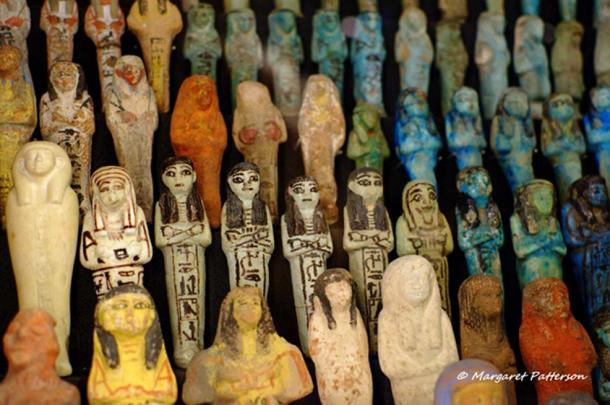 """Shabti (or Ushabti) dolls were ancient Egyptian """"Answerers"""" for the deceased in the Hereafter. An extensive collection of finely decorated figurines made from different materials, including faience and limestone, can be seen in this picture. Manchester Museum."""