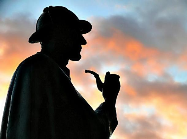 Silhouette of the statue of Sherlock Holmes located on Baker Street, London.