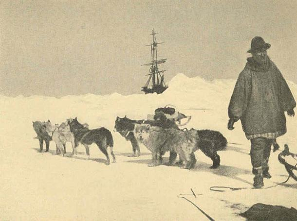 A Siberian man with his dog-team going over the ice off east cape, Siberia to a ship. (1926)