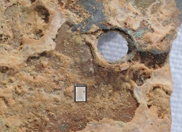 Significant accretion of mineral compounds within holes and cracks.