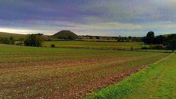 Silbury Hill, seen from the nearby hill on which West Kennet Long Barrow is located.