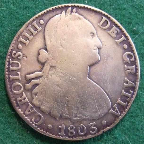 An 1803 Spanish piece of eight, a silver coin that circulated all around the world then.