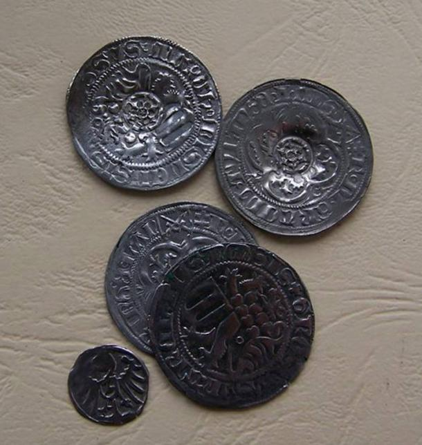 Silver coins found in a forest in Poland, as cleaned by archaeological restorers.