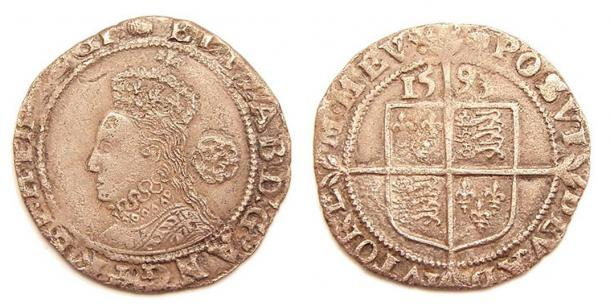 "Silver sixpence, struck 1593, identifying Elizabeth as ""by the Grace of God Queen of England, France, and Ireland"""