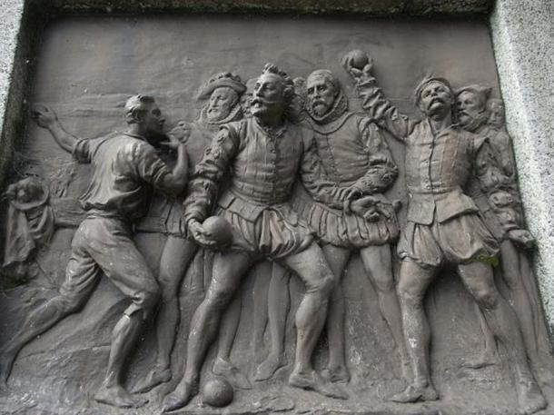 Sir Francis Drake whilst playing bowls on Plymouth Hoe is informed of the approach of the Spanish Armada. Bronze plaque by Joseph Boehm, 1883, base of Drake statue, Tavistock.