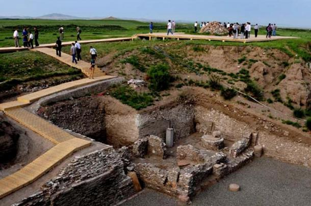 Tourists use a new boardwalk to get up close to residential ruins at the Site of Xanadu.