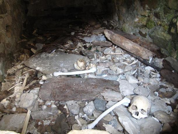 Skeletons inside Dargavs Crypt, Russia