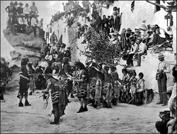 """Snake Dance at Walpi with spectators, """"Snake Rock"""" on the left. (Author provided)"""