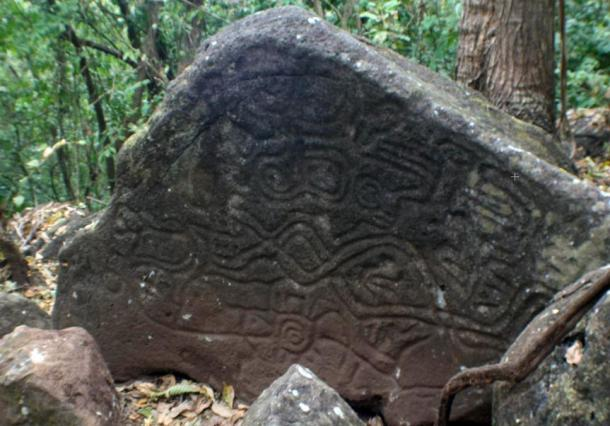 Snake-like petroglyphs on a rock on Ometepe island