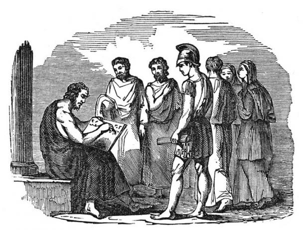 Solon writing laws for Athens