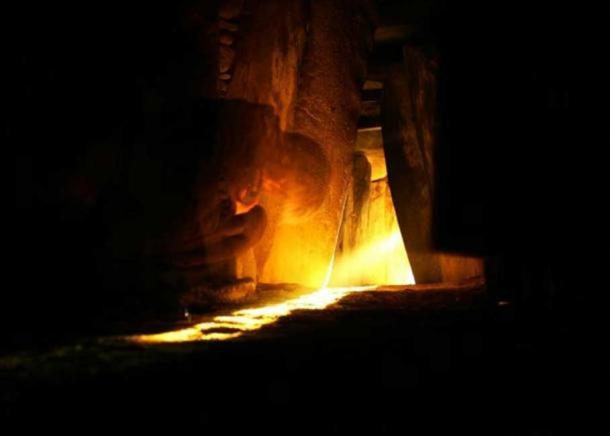 Solstice sunrise light entering the Newgrange monument, a photo by Cyril Byrne of the Irish Times, as seen on NASA's