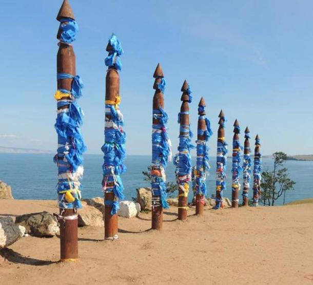 Spirit poles at Lake Baikal. The various colors of fabric summon different classes of spirit. (Alistair Coombs)