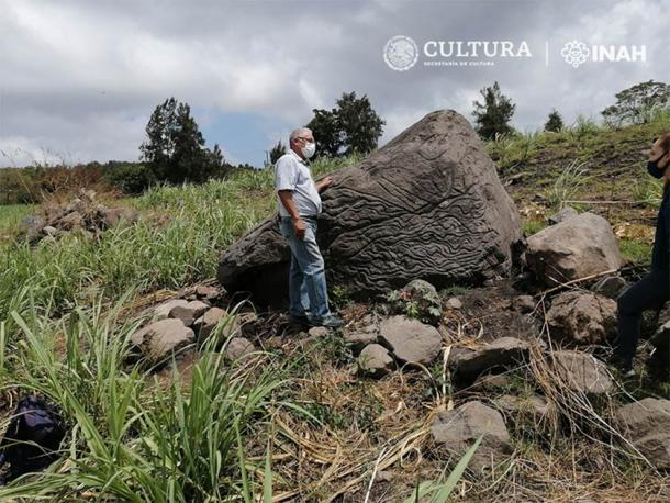 Staff from the INAH Colima Center inspecting the newly discovered Mexican stone map that predates the Chanal or Postclassic Colimense phase (1000–1500 AD). (Image: Arqlgo. Rafael Platas Ruiz. INAH-Colima)