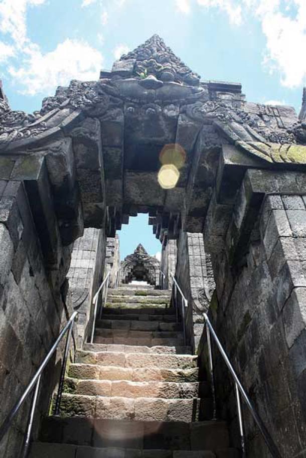 Stairs of Borobudur through arches of Kala