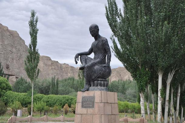 Statue of Kumarajiva in front of the Kizil Caves in Kuqa, Xinjiang province, China.