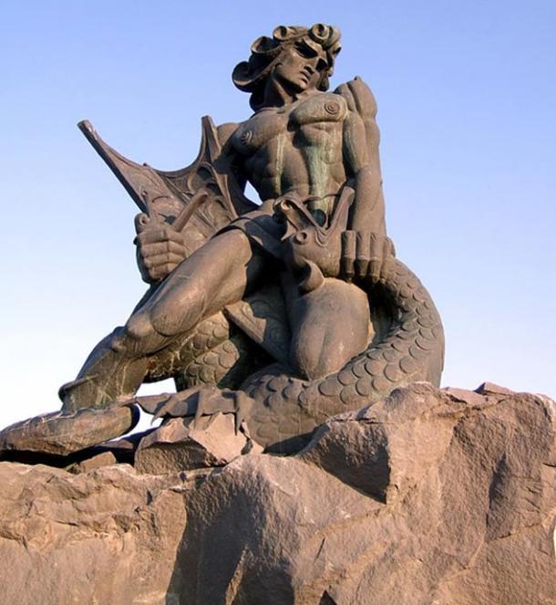 Statue of Vahagn the Dragon Slayer choking a dragon in Yerevan.