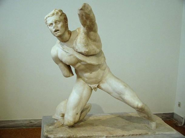 Statue of a fighting Gaul dropped to one knee with left arm raised in defence.