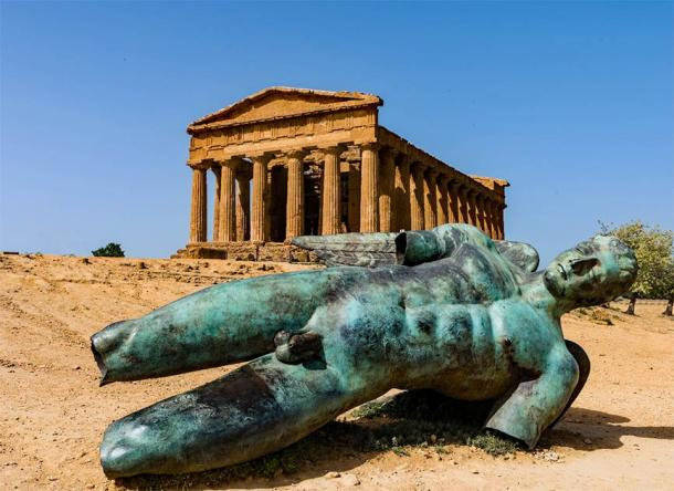 A bronze Greek statue in front of the Concordia Temple in Agrigento's Valley of the Temples, not far from where the statue of Atlas was found lying on the ground. (majonit / Adobe Stock)