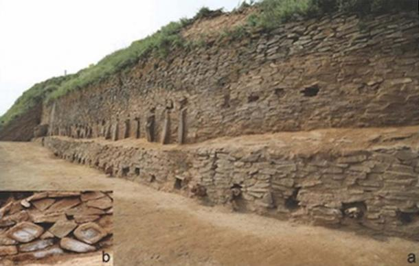 Stone buttresses defend the second and third levels of the step pyramid structure. There are symbols within the stonework. (Image: Zhouyong Sun and Jing Shao/Antiquity)