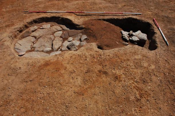 Stone-lined oven and rake-out material at Roman marching camp. (GUARD Archaeology / Fair Use)