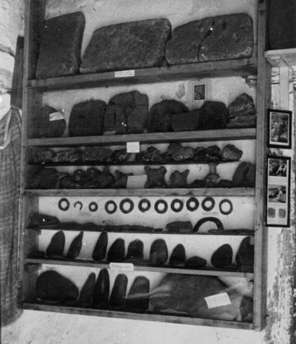 Stone or clay tablets and other artifacts in the Glozer museum. 1920s.