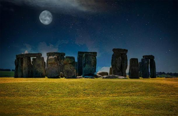 Stonehenge at night with stars and the Moon in the sky. (Michelle / Adobe stock)