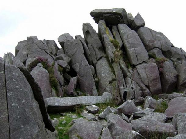 Stones at Carn Menyn, Wales, as an example of bluestone.These dolerite slabs, split by frost action, seem to be stacked, and ready for the taking.