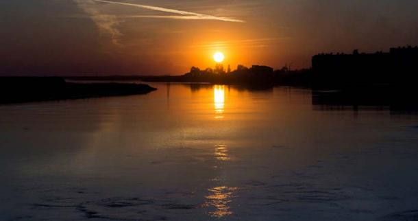Sunset over Sir-Darya river, Kazakhstan. In Ancient Greek river is called Yaxartes (Jaxartes)