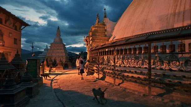 Swayambhunath at night in modern Kathmandu.