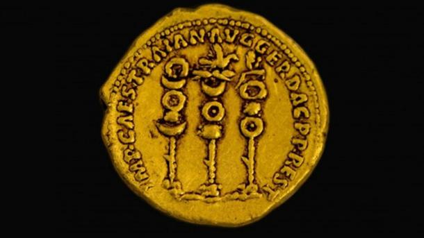 Symbols of the Roman legions next to the name of the ruler Trajan on a 2,000-year-old gold coin found in northern Israel.